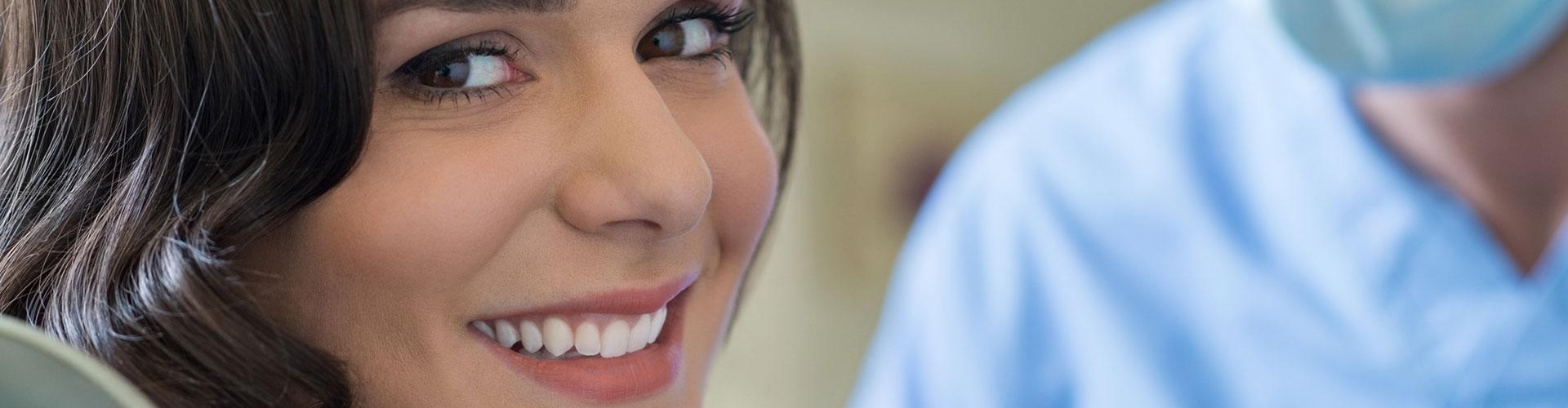 A happy woman having dental filling at Bella Hanono Family Dentistry