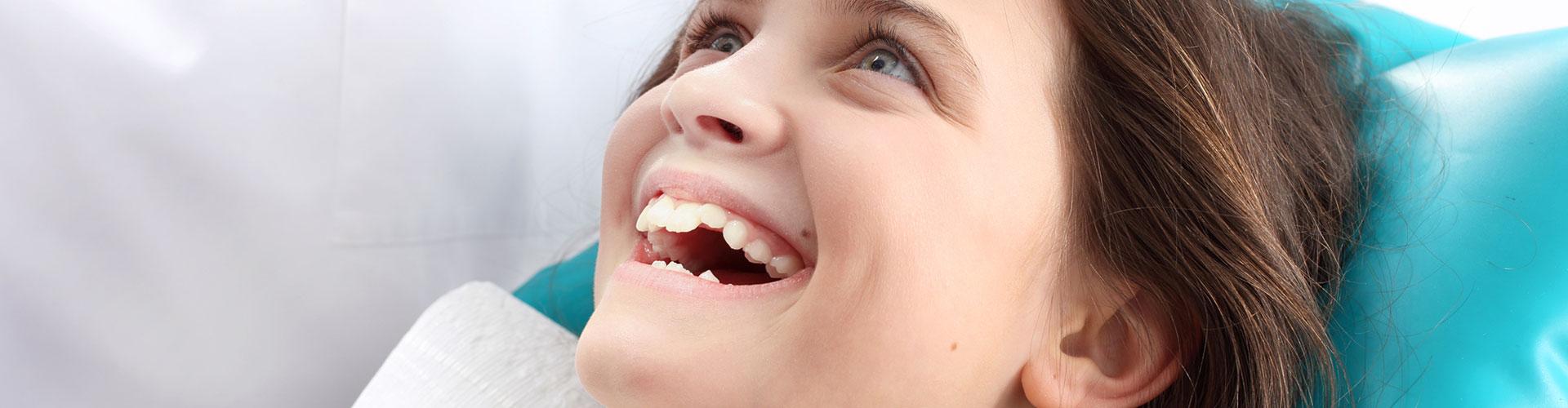 Happy girl using dental sealant at Bella Hanono Family Dentistry