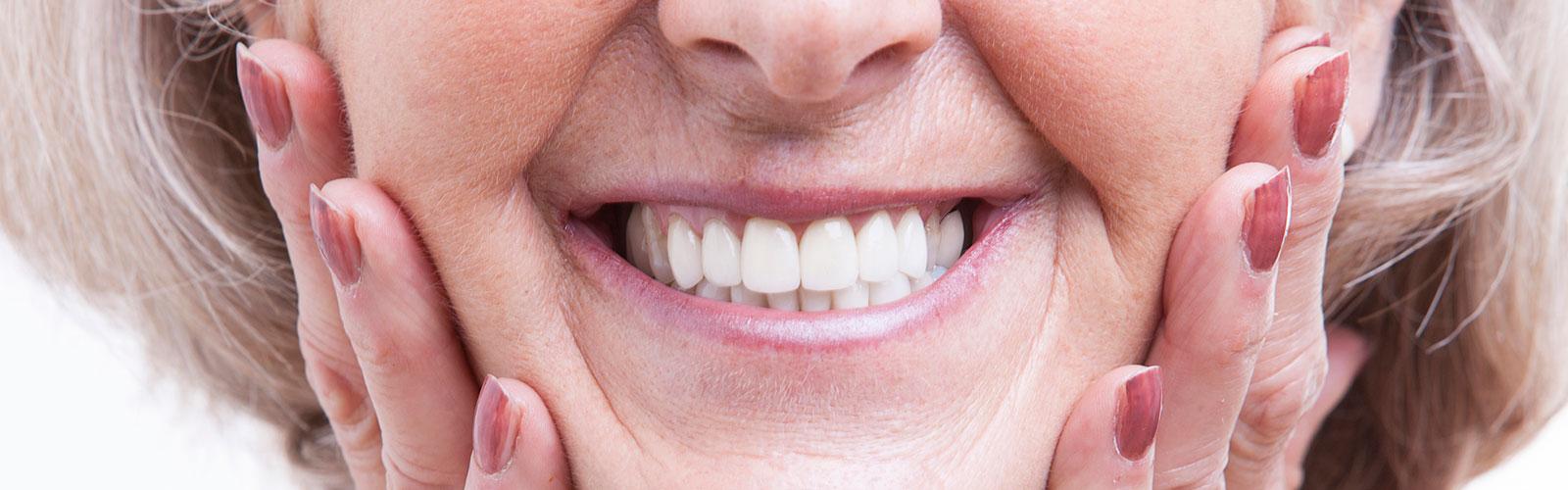 Happy patient of Bella Hanono Family Dentistry who had dentures done