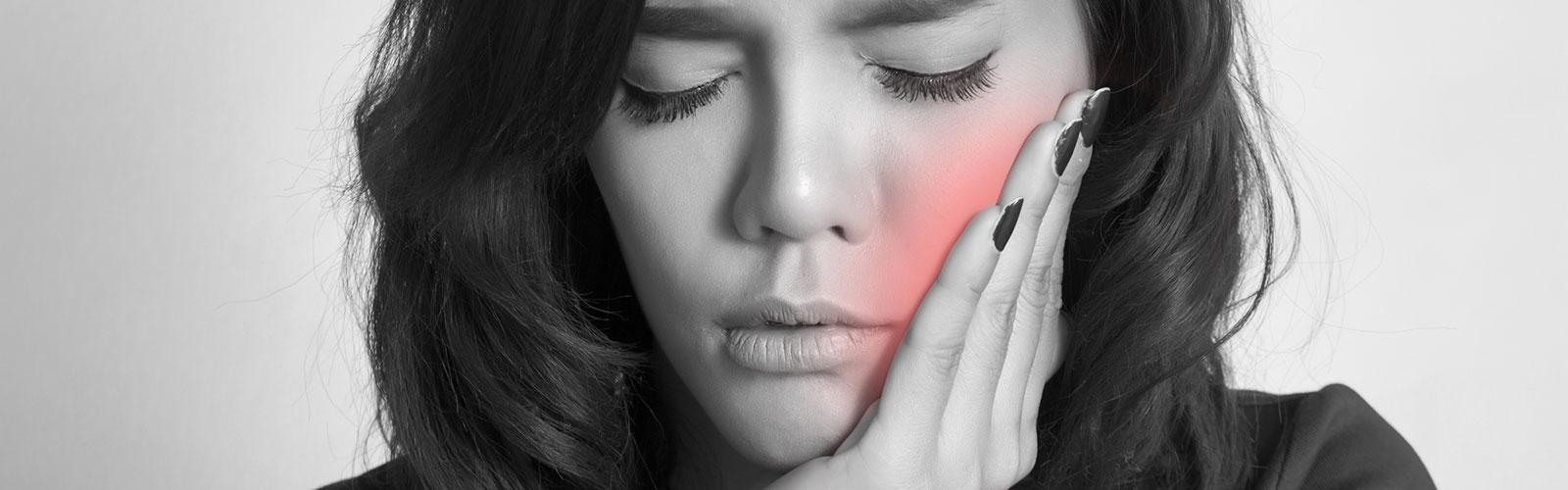 A woman who's having TMJ pain
